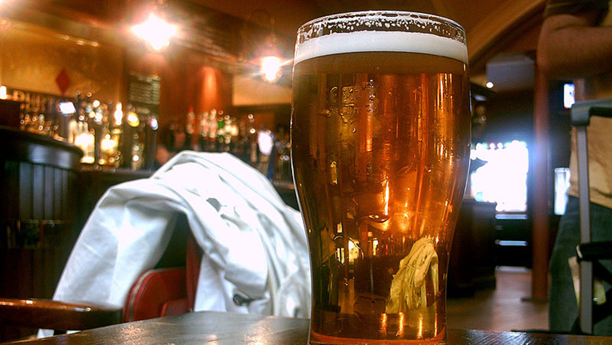 A pint of beer served in a British pub