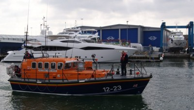 RNLI Lifeboat and Sunseeker Yacht in Poole Harbour Photo: Peter Elsdon
