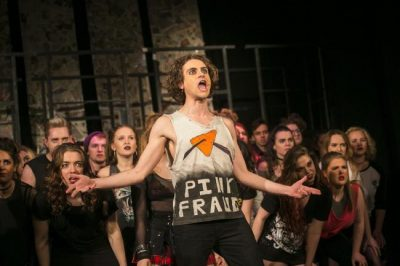 A photograph of cast members performing in American Idiot