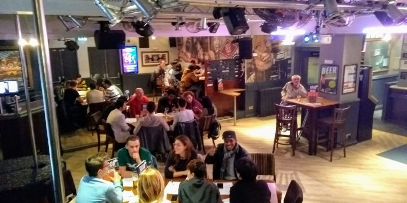 A picture of people learning English in a Bournemouth bar
