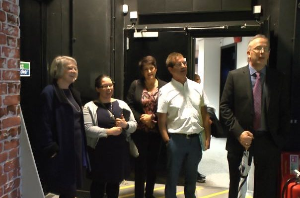Kate Adie stands with BU staff in TV studio