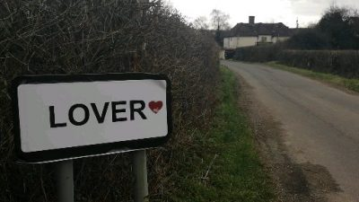 Lover village road sign with a heart on