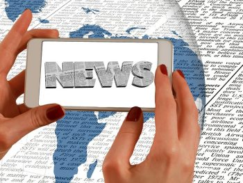 Image of Mobile Phone showing news content from a Newspaper