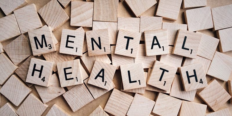 Scrabble letters spelling out the words 'mental health.'