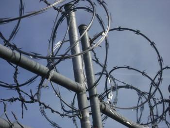 Image of razor wire outside a prison