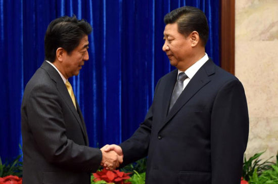 Two leaders shake hands. Photo by: Ma Zhancheng of Xinhua news agency.