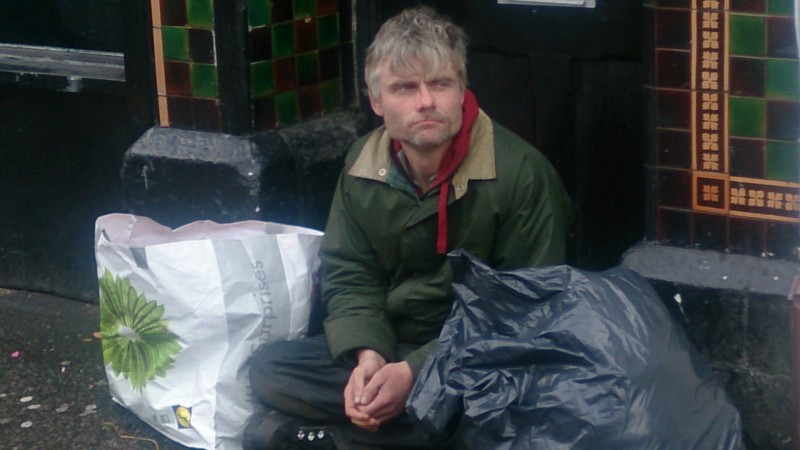 Homeless man on Old Christchurch road in Bournemouth Photo: Al Mansaray