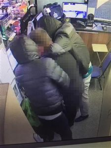 a CCTV image of two men robbing a petrol station in Bournemouth