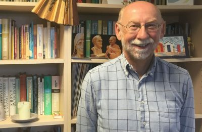 Photo of Dr Bill Merrington in his office
