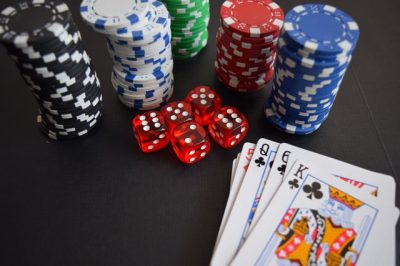 Cards, dice and betting chips.
