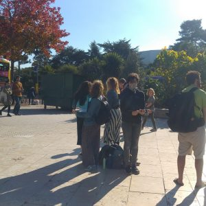 Small group holding laptops in Bournemouth Square