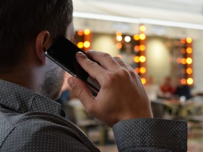 man stood with phone to ear