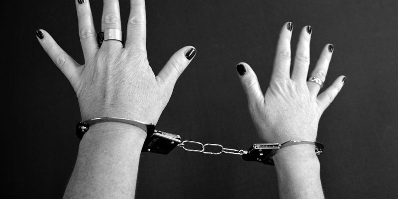 Womans hands in handcuffs