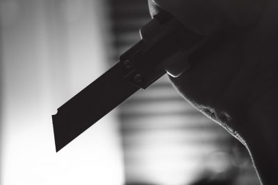black and white pictures of someone holding a knife