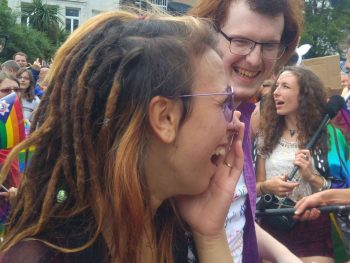 two people laughing at pride