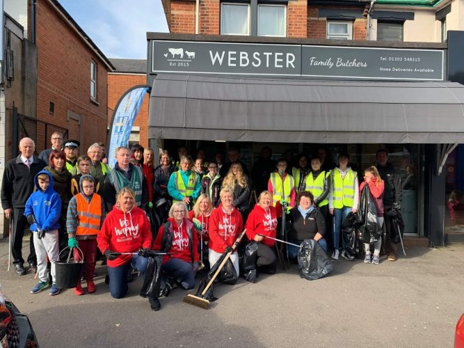 Winton locals outside Webster family butches before the high street clean up