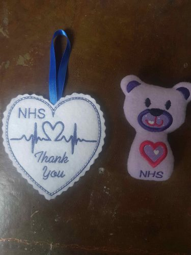 "Alaine Griffin's designs of a small teddy bear and love heart emblazoned with ""Thank you NHS"""