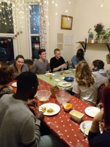 Photo shows friendly dinner in missional house where crack cocaine and drugs used to be peddled